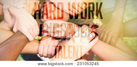 Hard work beats talent against friends putting their hands together