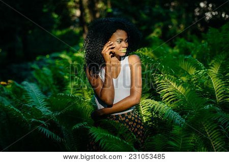 Sensual Portrait Of The Alluring Young African Model With Green Make-up Looking Aside Being Among Fe