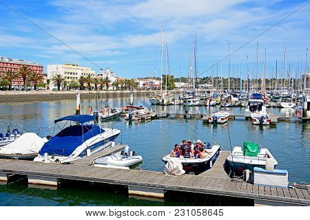 Lagos, Portugal - June 9, 2017 - View Of Boats And Yachts Moored In The Marina De Lagos With People