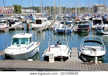 Lagos, Portugal - June 9, 2017 - View Of Boats And Yachts Moored In The Marina De Lagos With A Heron