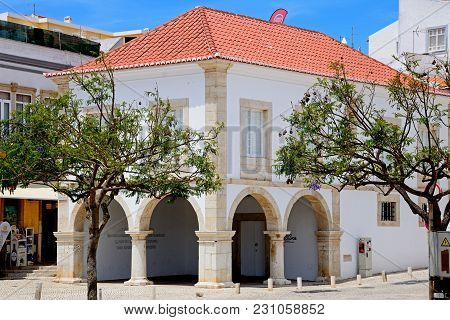 Lagos, Portugal - June 9, 2017 - View Of The Old Slave Market Building In The Town Square, Lagos, Al