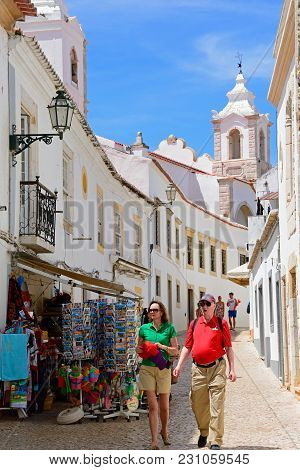 Lagos, Portugal - June 9, 2017 - Tourists Walking Along R Henrique Correia Da Silver Street Towards
