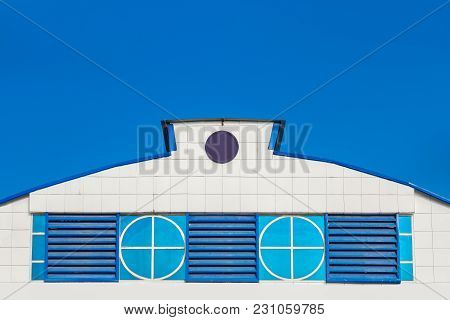 Brand New Gray Rooftop Tiles Against Blue Sky