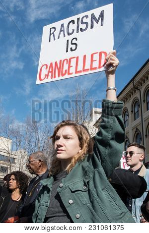 Woman With Racism Sign