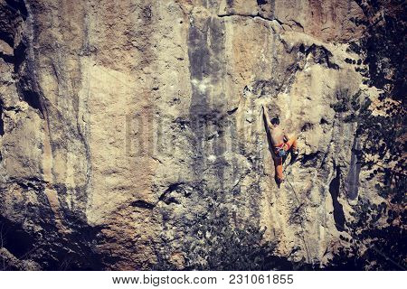 Rock-climbing In Turkey. The Climber Climbs On The Route. Photo From The Top.