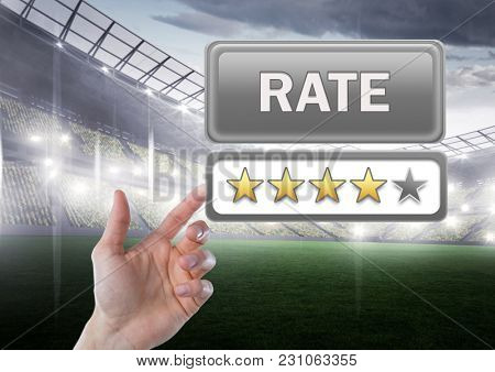 Digital composite of Hand pointing at Rate button and star reviews with sports stadium pitch