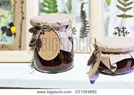 Banks With Homemade Jam.  Preserved Fruits. Homemade Jam In Jar Covered With Paper. Strawberry Jam