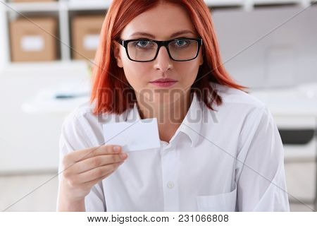Female Hand In Suit Give Blank Calling Card To Visitor Closeup. White Collar Partners Company Name E