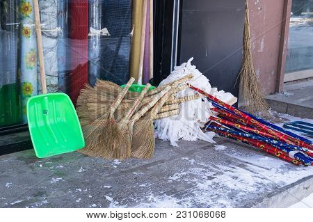 Set For Cleaning - Brooms, Shovels And Mops Are Sold On The Market In The Market