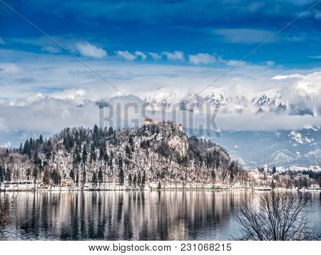 The Bled Lake with the view of the Bled Castle and Church of the Asumption of Maria on Bled island, against the majestic Alps in the background, Slovenia, Europe
