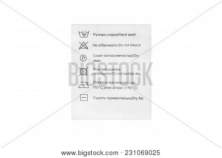 Care Clothes Label In English And Russian Languages Isolated Over White