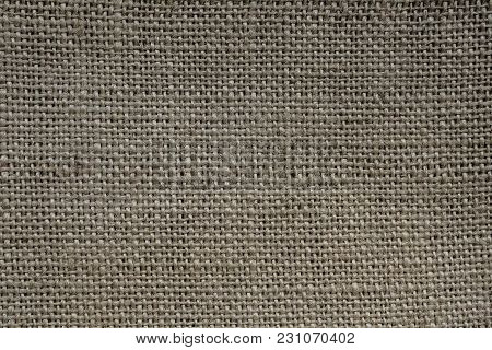 Natural fabric. Grey fabric background. Cloth background. Fabric texture. Fabric background. Grunge backdrop.  Grunge style. Sacking. Natural style. Rough material.