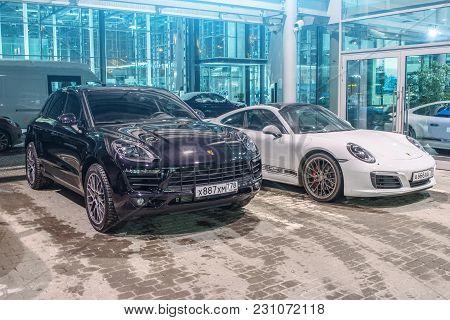 Porsche Black Macan S And Porsche White 911 Carrera 4s. Russia, Saint-petersburg. 02 March 2018