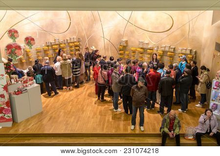 Paris, France, March 27 2017: Tourists at presentation hall of perfume of the Museum Fragonard Shop with tourists
