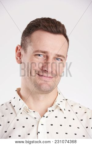 Portrait Of Proud Young Man Isolated On White Background