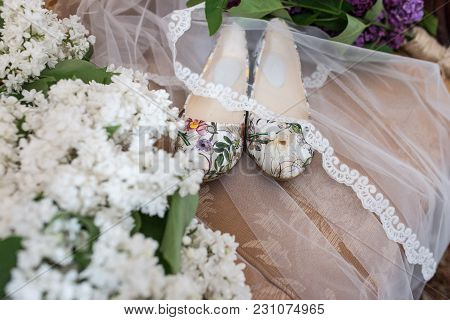 Shoes Without Heels With Colorful Flowers Are Covered With A Veil. Wedding Shoes