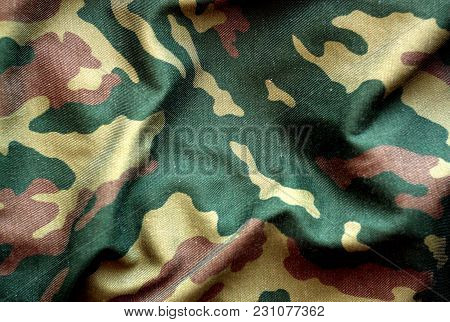 Military Uniform Pattern With Blur Effect. Abstract Background And Texture.