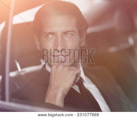 closeup.successful businessman sitting in the car