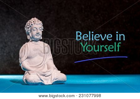 Believe In Yourself. Inspirational And Motivating Phrase Near Little Buddha Figurine.