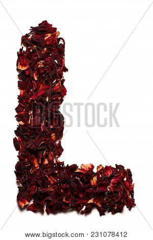 English Alphabet. Letter L From Dried Flowers Of Hibiscus Tea On A White Background. Letters For Ban