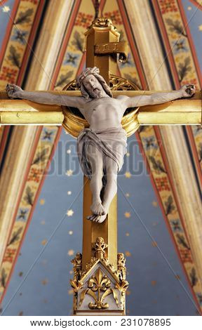 ZAGREB, CROATIA - APRIL 15: Cross on the main altar in Zagreb cathedral dedicated to the Assumption of Mary in Zagreb on April 15, 2015.