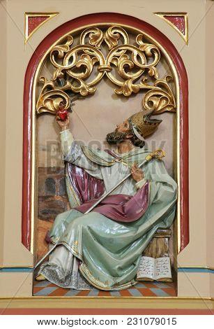 SISAK, CROATIA - DECEMBER 07: Saint Augustine of Hippo, Great Doctors of the Western Church, pulpit in the Church of Holy Cross in Sisak, Croatia, on December 07, 2017.