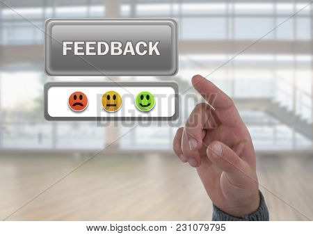 Digital composite of Hand pointing at feedback button and smiley faces review in large hall room