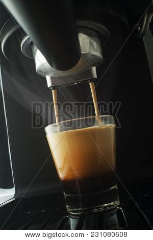 Espresso Pouring From Coffee Machine. Professional Coffee Brewing