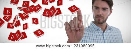 Man pretending to touch an invisible screen against bit coin symbol
