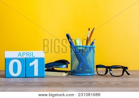 April 1st. Day 1 Of April Month, Calendar On Table With Yellow Background And Office Or School Suppl