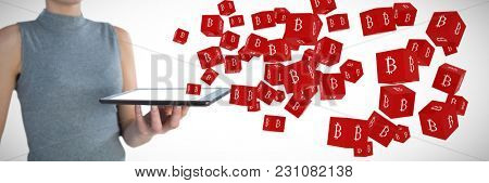 Mid section of businesswoman holding tablet computer against several red cube with bit coin sign on each side