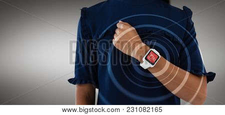 Female executive showing smart watch against digital composite of heart icon