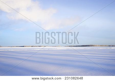 The Desolate Winter Landscape Of Snow And Shadows To The Foreground