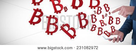 Mid section of businessman gesturing over mobile phone against several big red bit coin sign