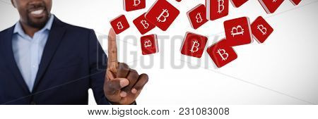 Classy businessman pointing his finger while talking against bit coin symbol