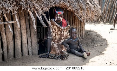 Omo Valley, Ethiopia, September 2017: Portrait Of Unidentified Karo Tribe Woman With Her Child In Co