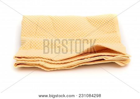 Yellow Chamois (microfiber Towel) For Cleaning Concept On White Background
