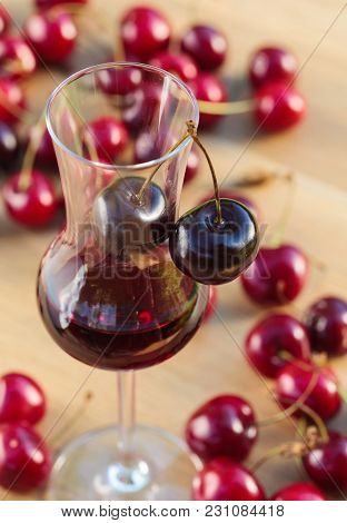 Cherry Liquor And Juicy Ripe Berries On Table.