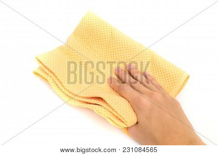 Hand Using Yellow Chamois (microfiber Towel) For Cleaning Concept On White Background