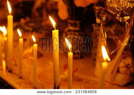 Yellow Wax Candle In Temple. Religious Beliefs In Buddhism.