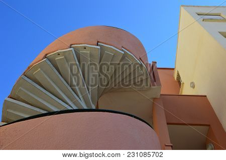 Zoom On A Spiral Staircase With Blue Sky Background