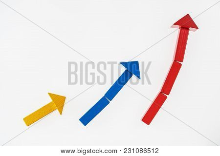 The Concept Of Success. Business Graph. Growth Progress Concept With Arrows. Growing Graph Of Wooden
