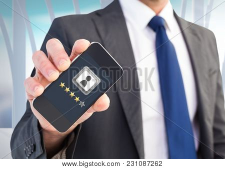 Digital composite of Rating review stars on phone in man's hand