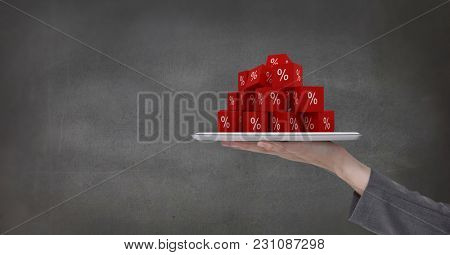 Digital composite of Hand holding tablet with percent symbol icons