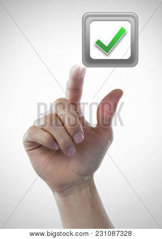 Digital composite of Hand touching correct tick box