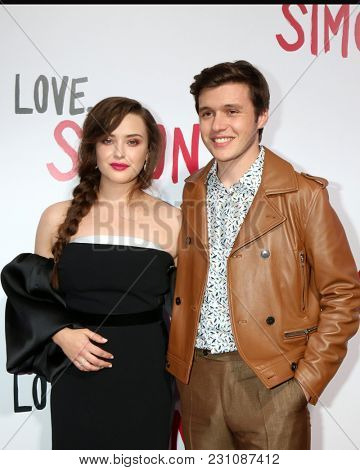 LOS ANGELES - MAR 13:  Katherine Langford, Nick Robinson at the