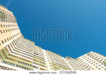 High-rise Apartment Building Against The Blue Sky