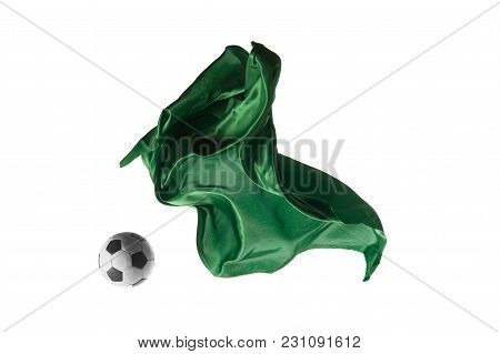 Soccer Ball And Smooth Elegant Transparent Green Cloth Isolated Or Separated On White Studio Backgro