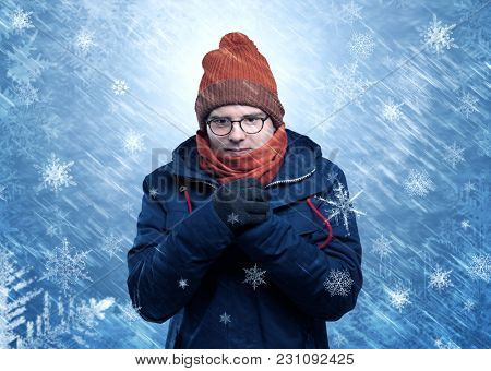 Gorgeous boy wearing warm clothing and freezing in cool snowy  concept
