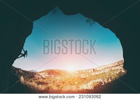 Silhouette Of A Climber.